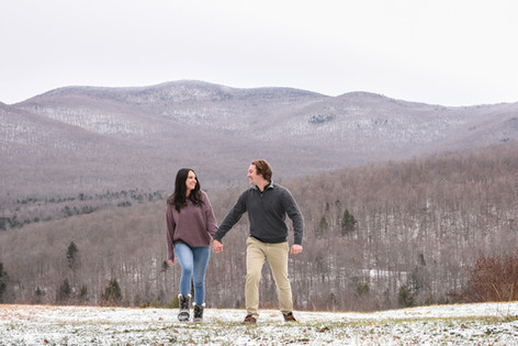 couple-engagement-proposal-walking-hand-in-hand-mountains-winter-Vermont
