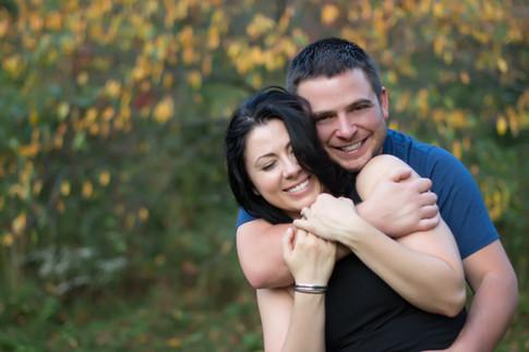 couple-engagement-smiles-fall-foliage-Vermont-Amanda-Starr