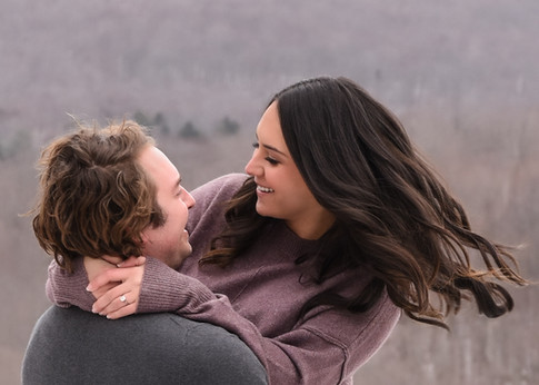 couple-engagement-smiles-fun-winter-Amanda-Starr