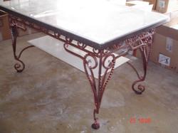 стол со столешницей из искусственного камня с кованой опорой