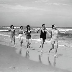 1930s-four-women-and-one-man-running-vin