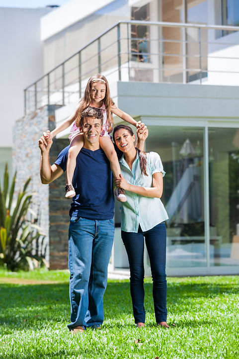 happy family smile in front of house outdoor, parents with child daughter.jpg