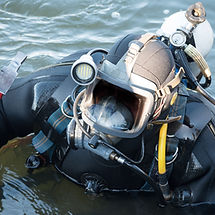 commercial  diver with scuba gear workin