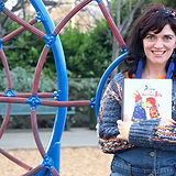 Julia_Kosivchuk with a book on a playground