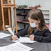 Students writes a letter.jpg