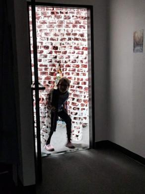 A girl is running through the door