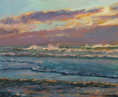 a sunset and sea waves