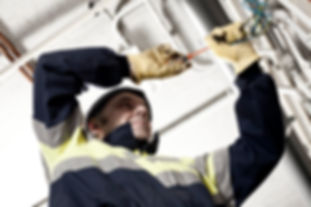SAFEgroup Automation - Man in PPE working wit electrical wires