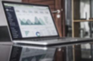 SAFEgroup Automation - Lapto with analytics displayed