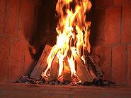 brasa öppenspis ved eld