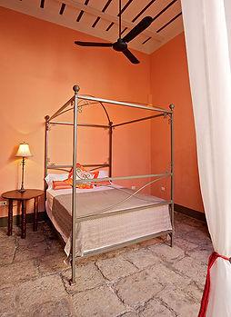bedroom iron bed cobblestone floor