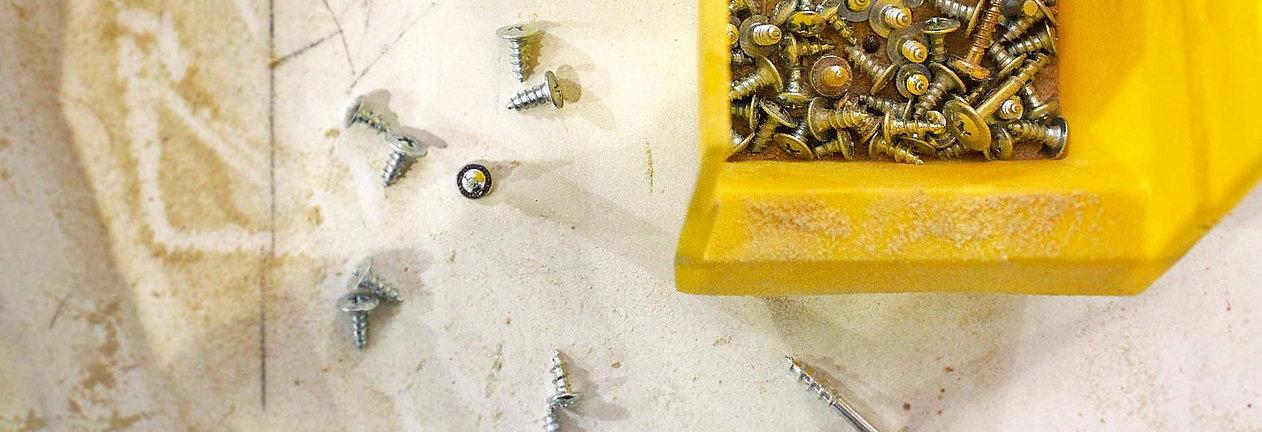Box of screws, screws, spilled screws