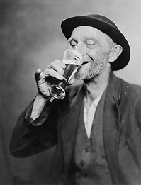 happy-old-man-drinking-glass-of-beer-eve