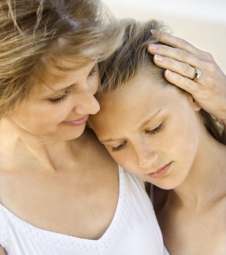 Daughter rests her head on her mother's