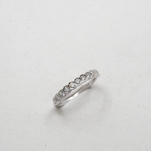 Bague diamants sertis demi clos
