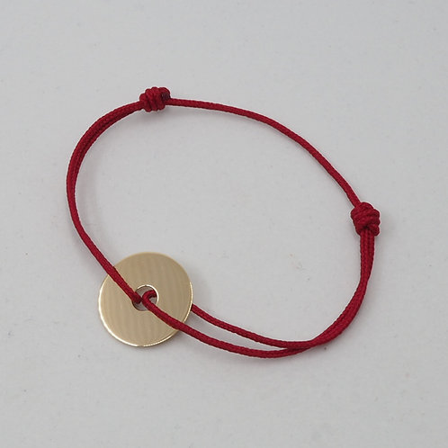 Bracelet médaille percée sur cordon