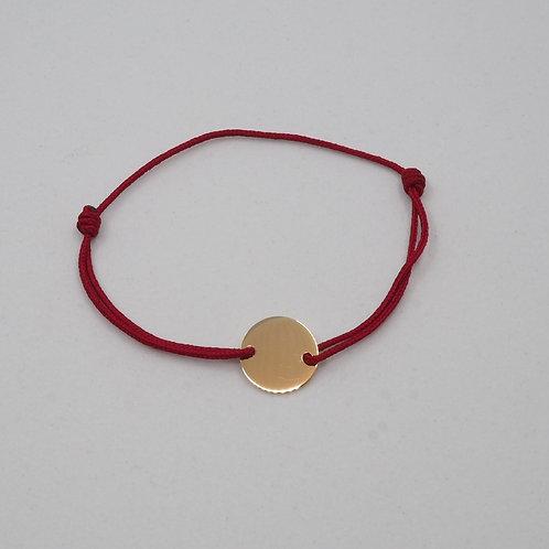 Bracelet médaille sur cordon