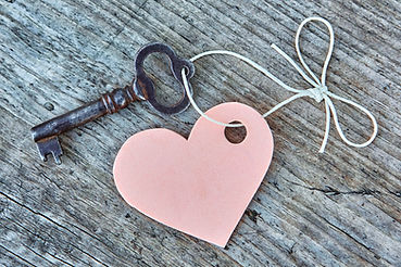Vintage key and pink heart on a string w
