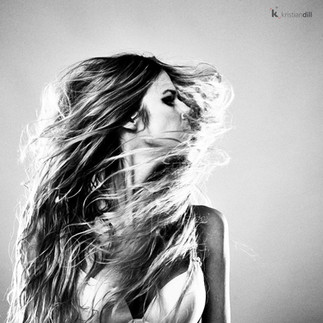 Woman black and white artistic with long flying hairsportrait