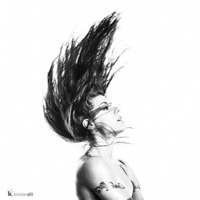 Flying hair black and white nude portrait with tatoo