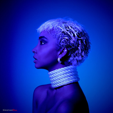 Blue artistic portrait with rope and jewellry