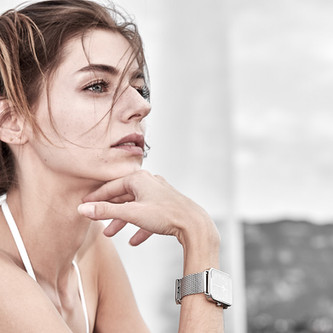 Woman portrait and hand with a swiss watch