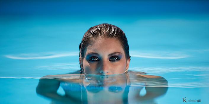 Beauty portrait in swimming pool