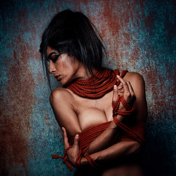 Coulour nude portrait with red rope