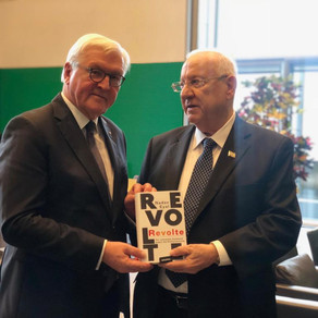 Israeli President Rivlin presents a German copy of Nadav Eyal's REVOLT to President Steinmeier
