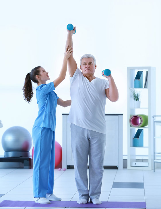 Physiotherapist working with patient in