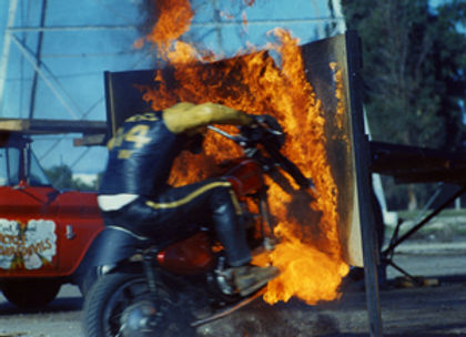 Evel Knievel motorcycle through fire.jpg