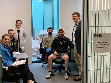 Economics Professors Michael Jones & Na Young Lee pictured with students in the Kautz-Uible Economics Institute's Blockchain Research Lab