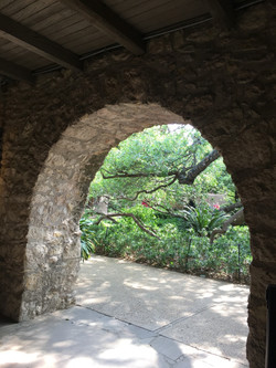Karen L Higgins, glimpse through an arch into the garden beyond at the Alamo, San Antonio