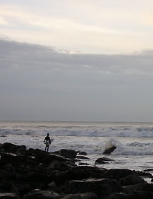 Lone Surfer waiting for a lull