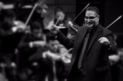Conducting the Caracas Symphony Orch