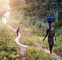 woman-carrying-water-sierra-leone-689056