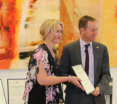 Lynette Lipovac is presented 2017 Carer of the Year Award by ACT Minister for Mental Heath ShaneRattenbury