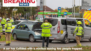 2 people trapped after car collides with minibus. Braunstone Leisure Centre