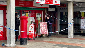 A city post office were robbed this morning at knifepoint