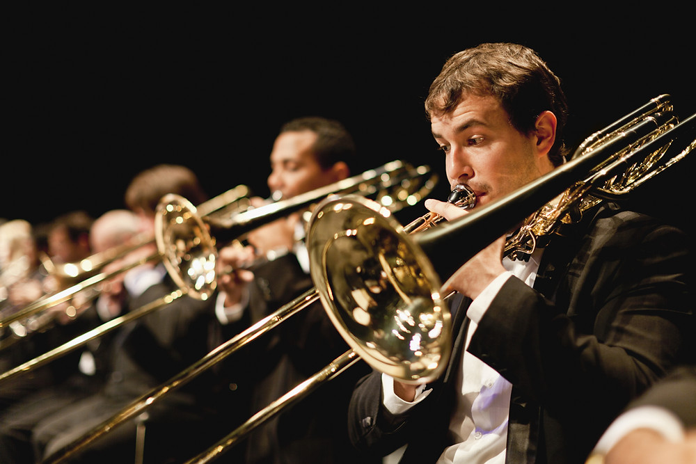 the file link for this photo is Trumpet players in Orchestra...WHEN WILL PEOPLE LEARN WHAT A TROMBONE IS?!