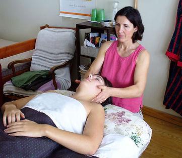 Massage Therapists Working on Women's Neck