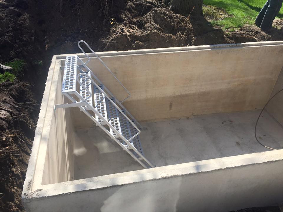 the bottom of a storm shelter with stairs