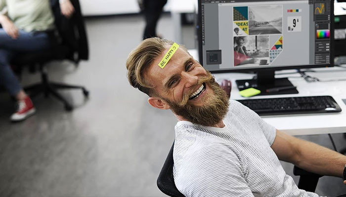 Man happy at his workspace