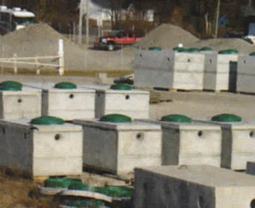 many precaster concrete septic tanks setting out site