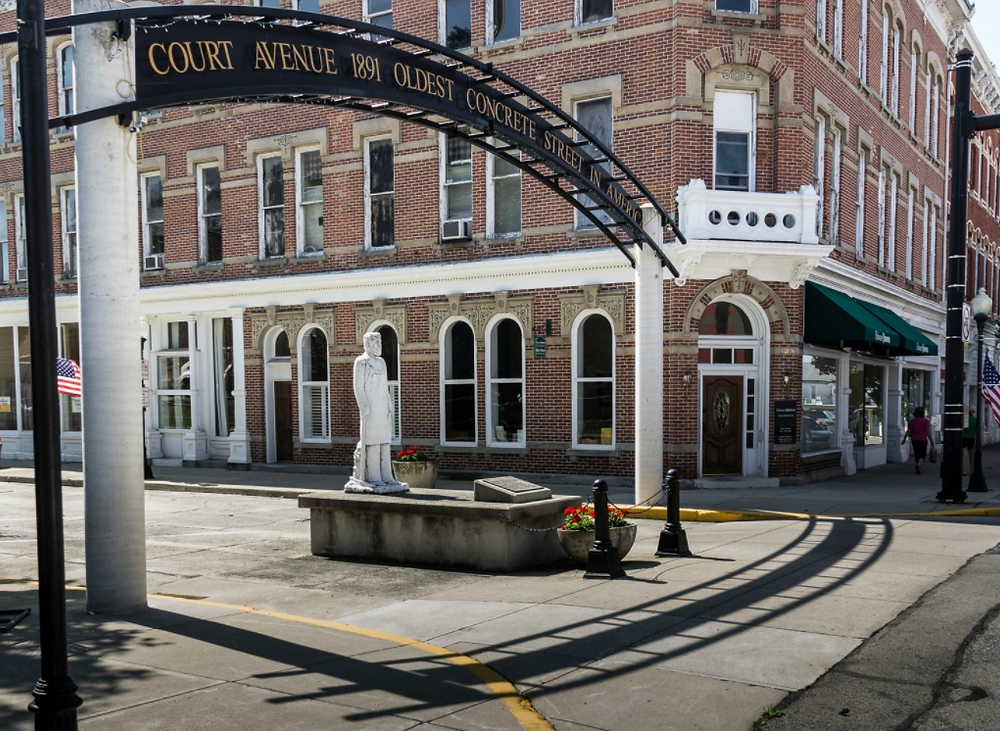 The first concrete street in the Americas was built in 1891 in Bellefontaine Ohio. Court Avenue in downtown Bellefontaine is no longer driven on today, but is still made solidly of concrete.