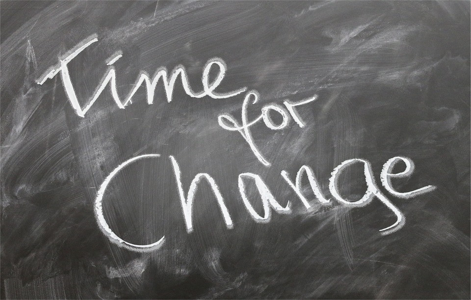 """A blackboard that reads """"time for change"""""""