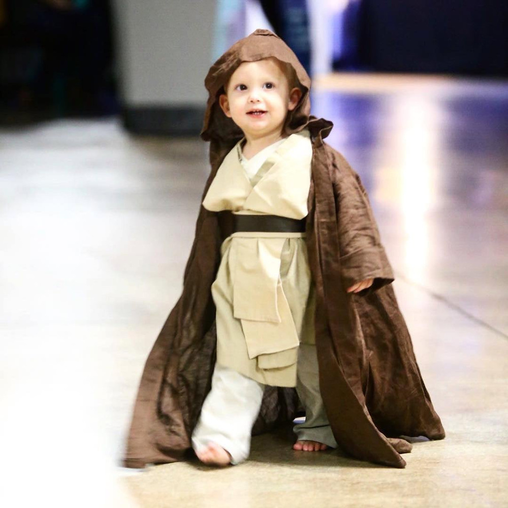 Child dressed up in play Star Wars Costume