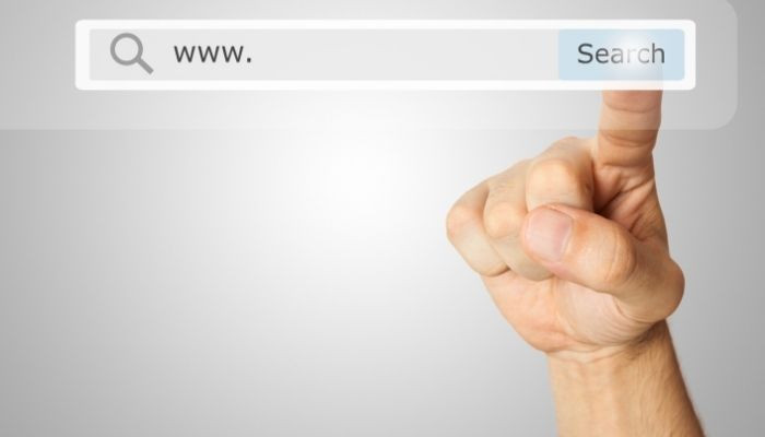 Finger pointing to search engine
