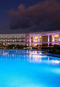melia-dunas-beach-resort-pool-bar-night.