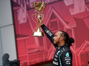 Hamilton scores 100th grand prix win in Russia as late rain denies Norris first victory
